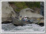 A Helfrich Adventure Driftboat running rapids on the Rogue.